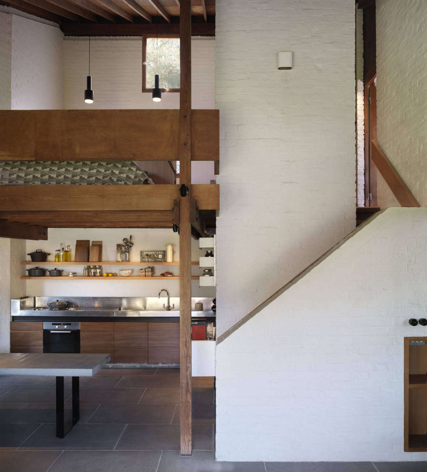 A sleep loft is just above the kitchen. All the wood used for the house&#8