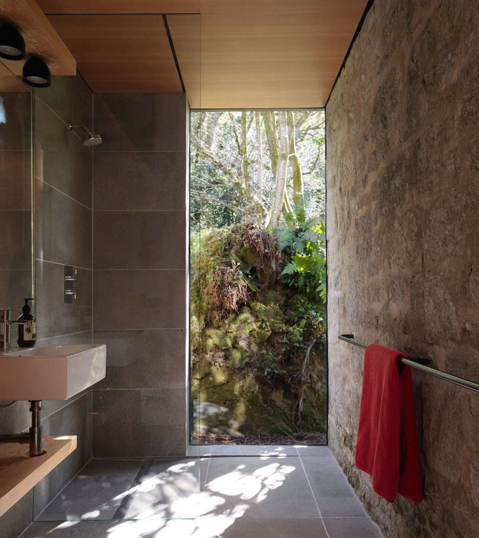 A bathroom, with a lush view, was added to the studio.