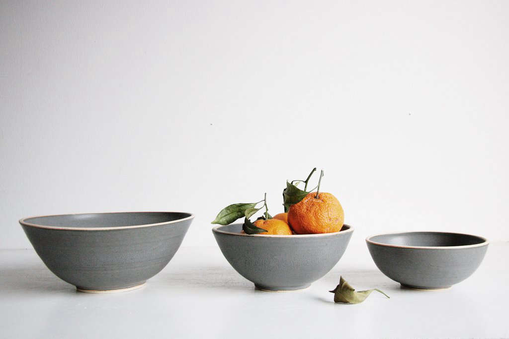The hand-thrown Silverlake Nesting Bowl Set comes in four colors: serenity blue, classic white, satin black, and charcoal (pictured); $3 for a set of three bowls from Sheldon Ceramics. (Featured image shows the other colors available.)