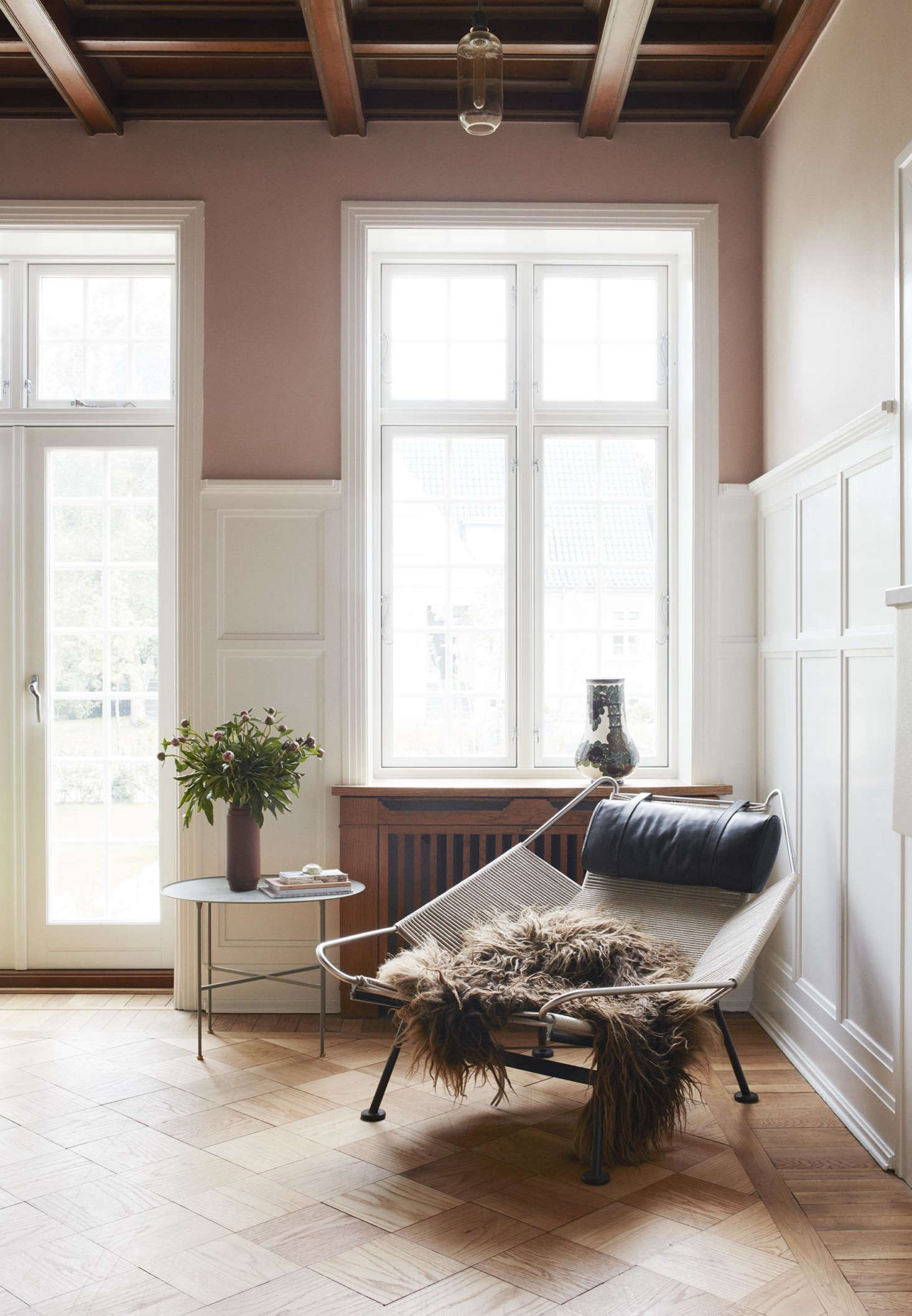 In another corner, a sheepskin is slung over a Wegner PP