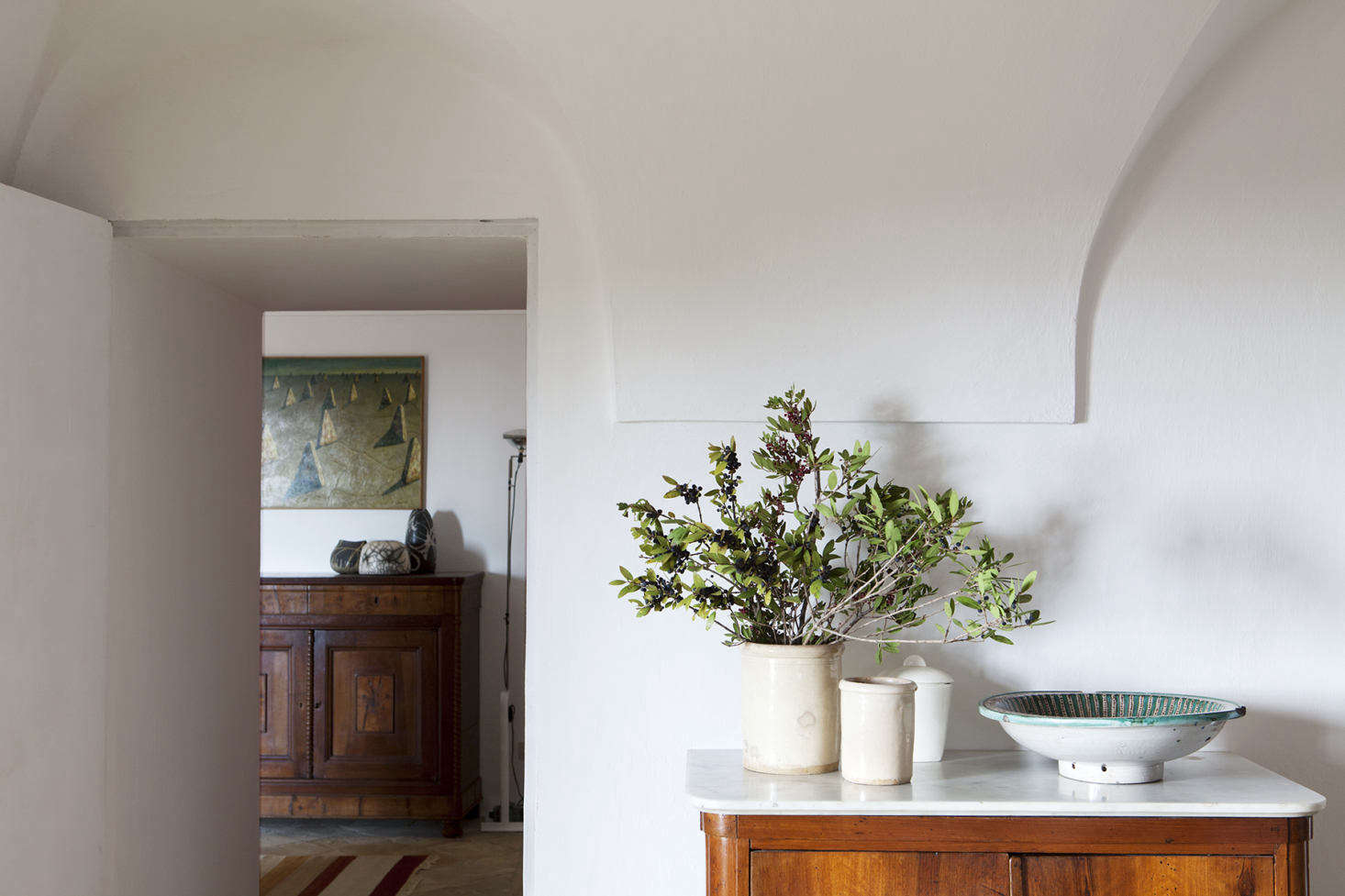 A simple arrangement of olive branches on a marble-topped credenza. Tenuta Borgia also has a working olive orchard and vineyard on the property.