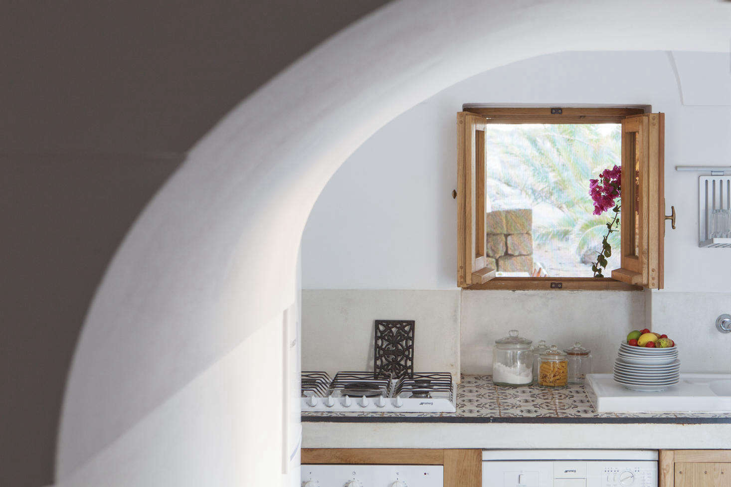 A small, tidy kitchen in Dammuso Vigna, which can accommodate a couple.
