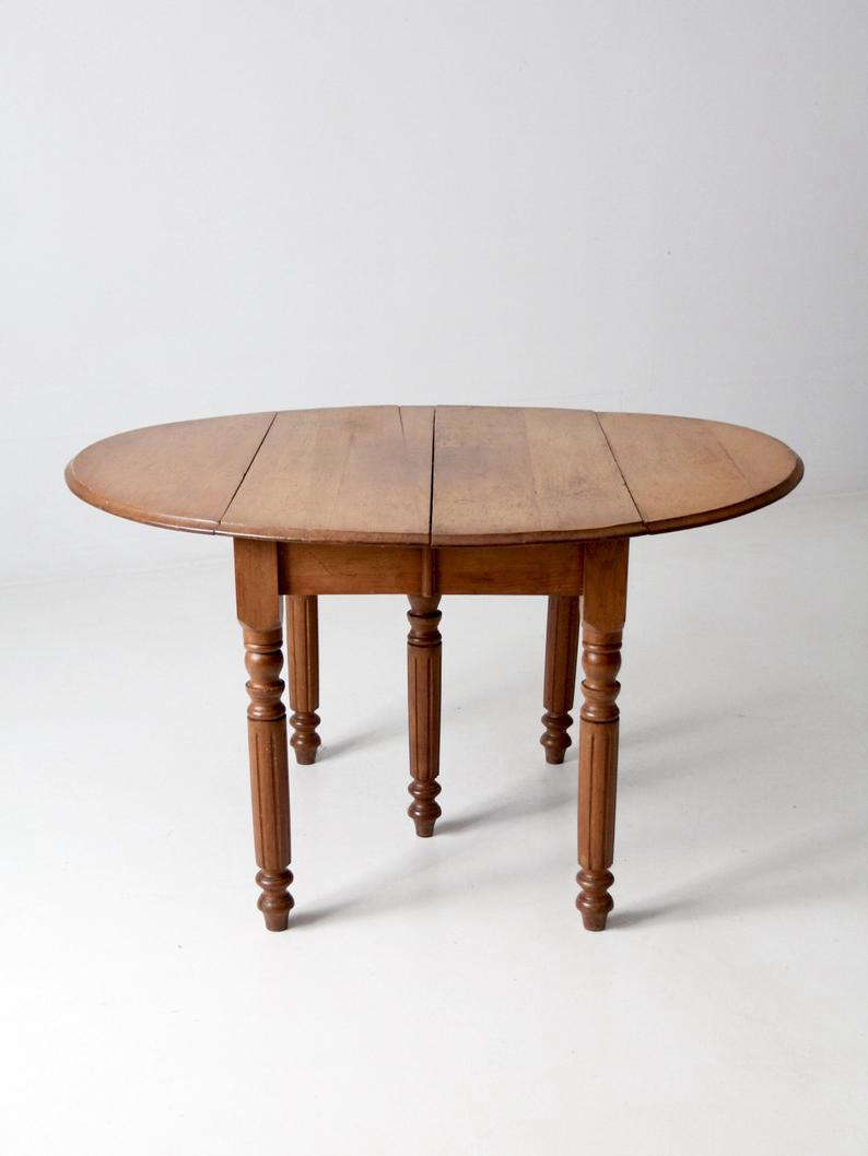As to be expected from an antiques dealer's home, much of the furniture is old. This Antique Dropleaf Farmhouse Table, from 86Home on Etsy, would be a perfect addition to a farmhouse kitchen; $1,402.50.