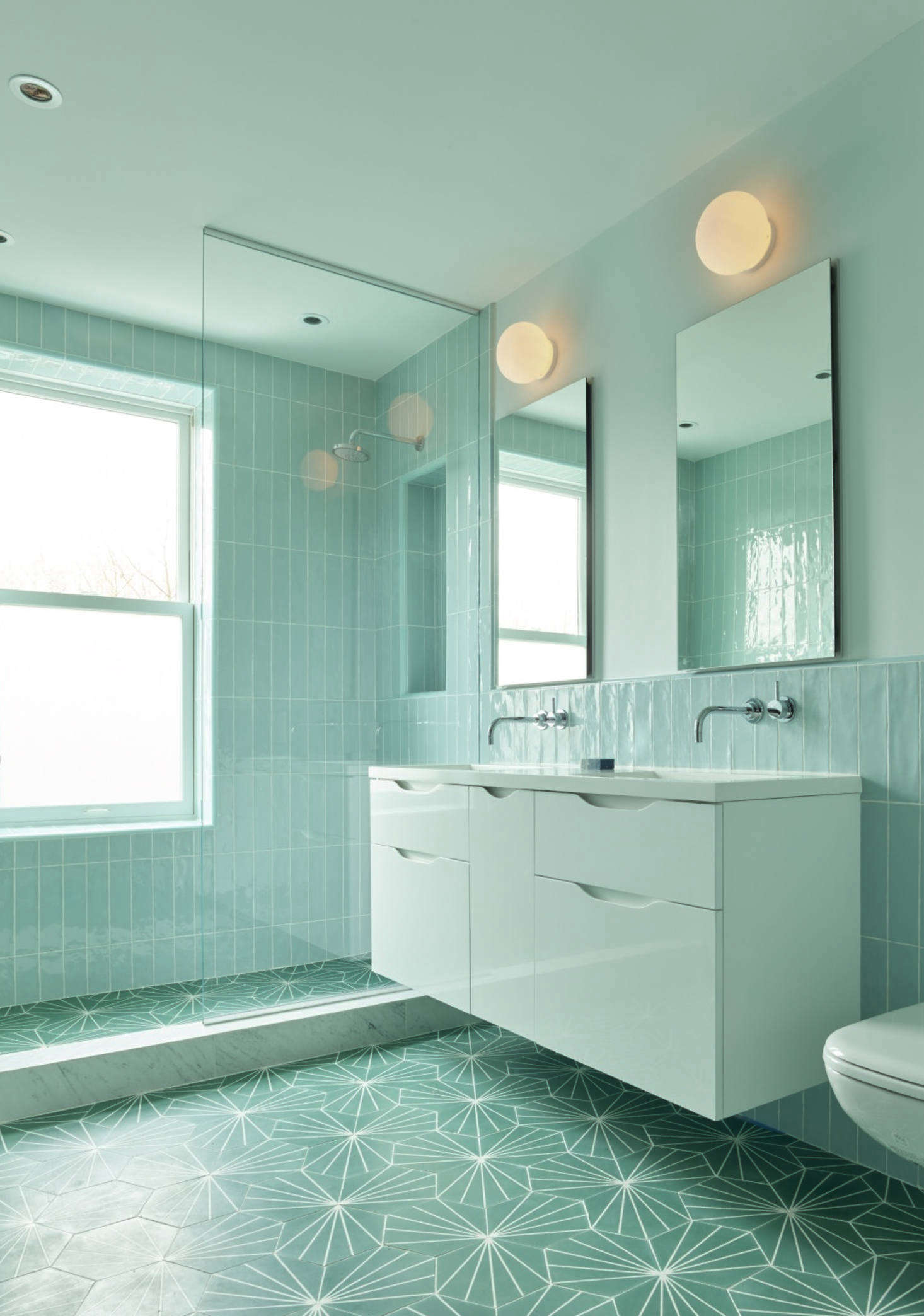 The girls' bath, in tone-on-tone sea-foam green, a collaboration between Spain and Kocher, the architect.
