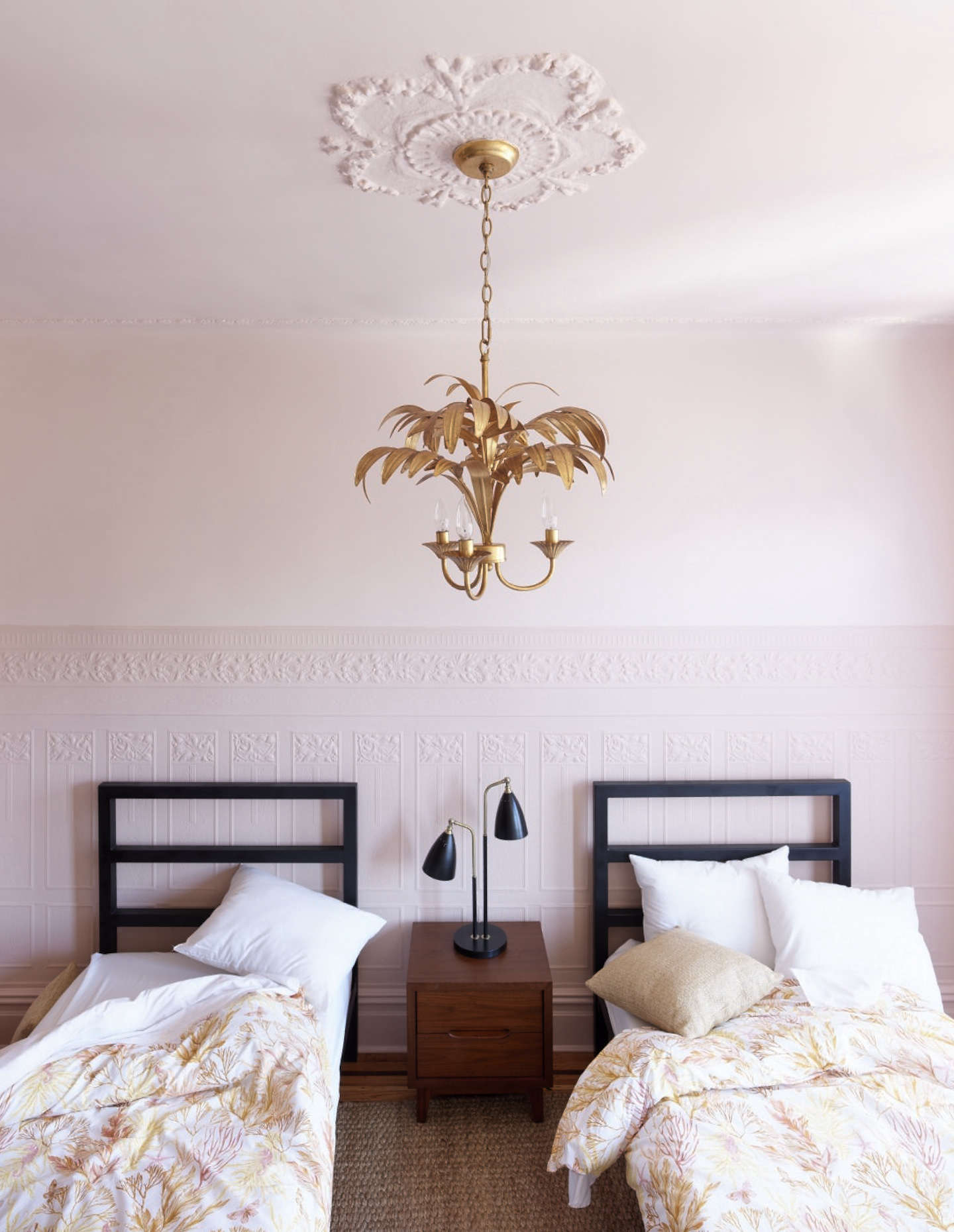 The girls' room has a pink-on-pink scheme tempered by black and a bit of irreverence.