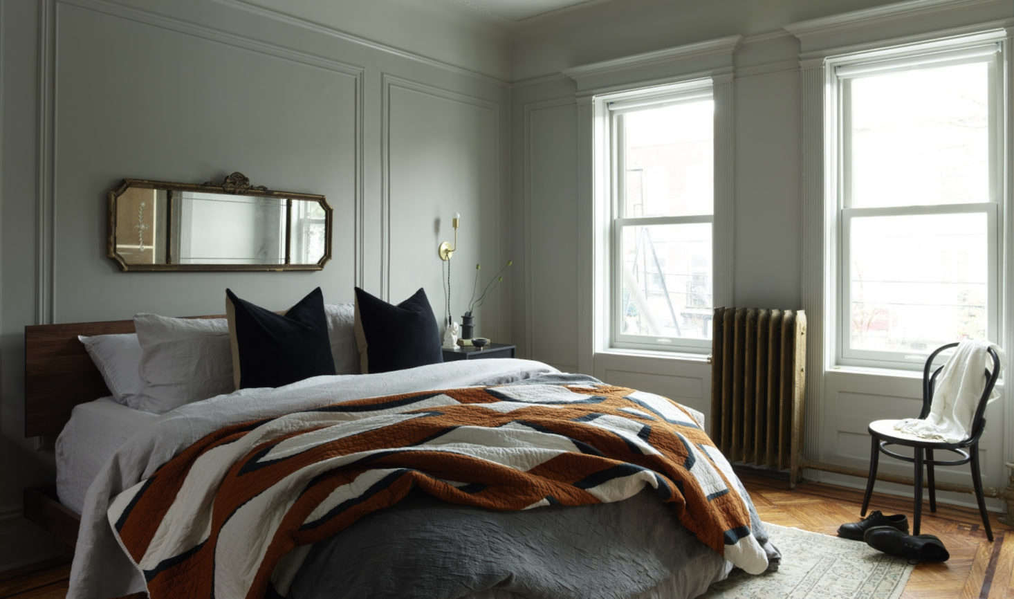 The second floor houses a master suite, Kocher's solution to make the previously awkward, chopped-up space feel more cohesive.