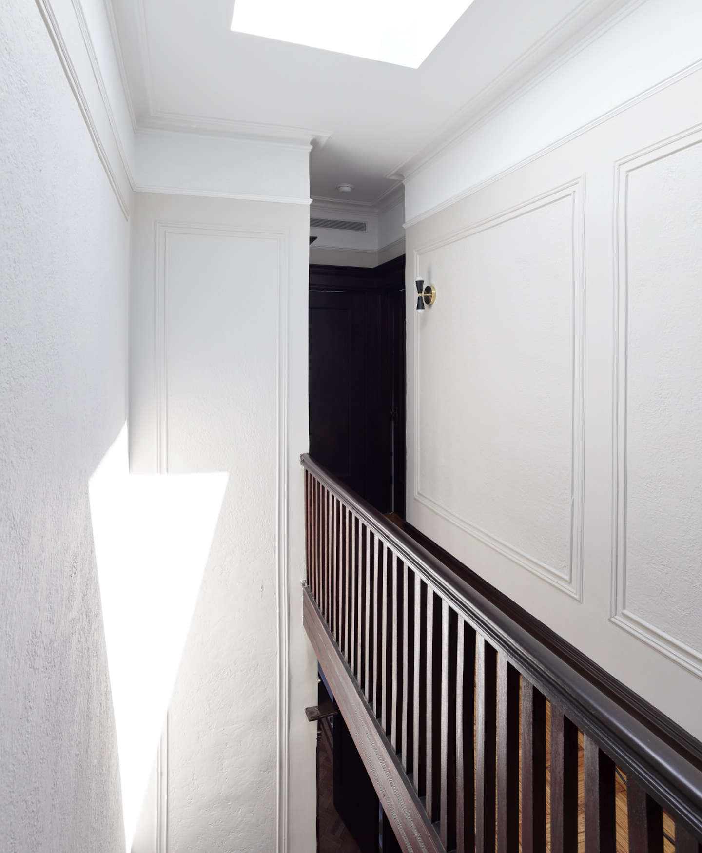 """Up to the top floor, the least traditional of the three. """"The sense of formality slowly fades away as you move upwards through the house, through the introduction of raw materials and more fluid shapes,"""" Spain says."""