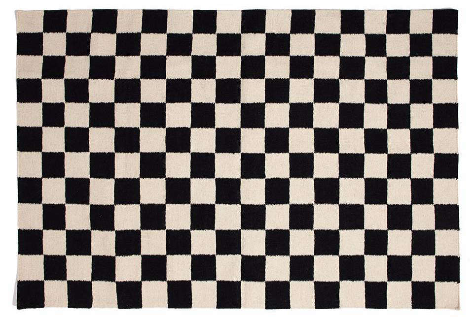 Jonathan painted the black and white checkered floor himself. For a great DIY tutorial, go here. Not up for the project? Consider this wool and cotton Checkmate Flatweave Rug by Aelfie; $89 to $1,889.