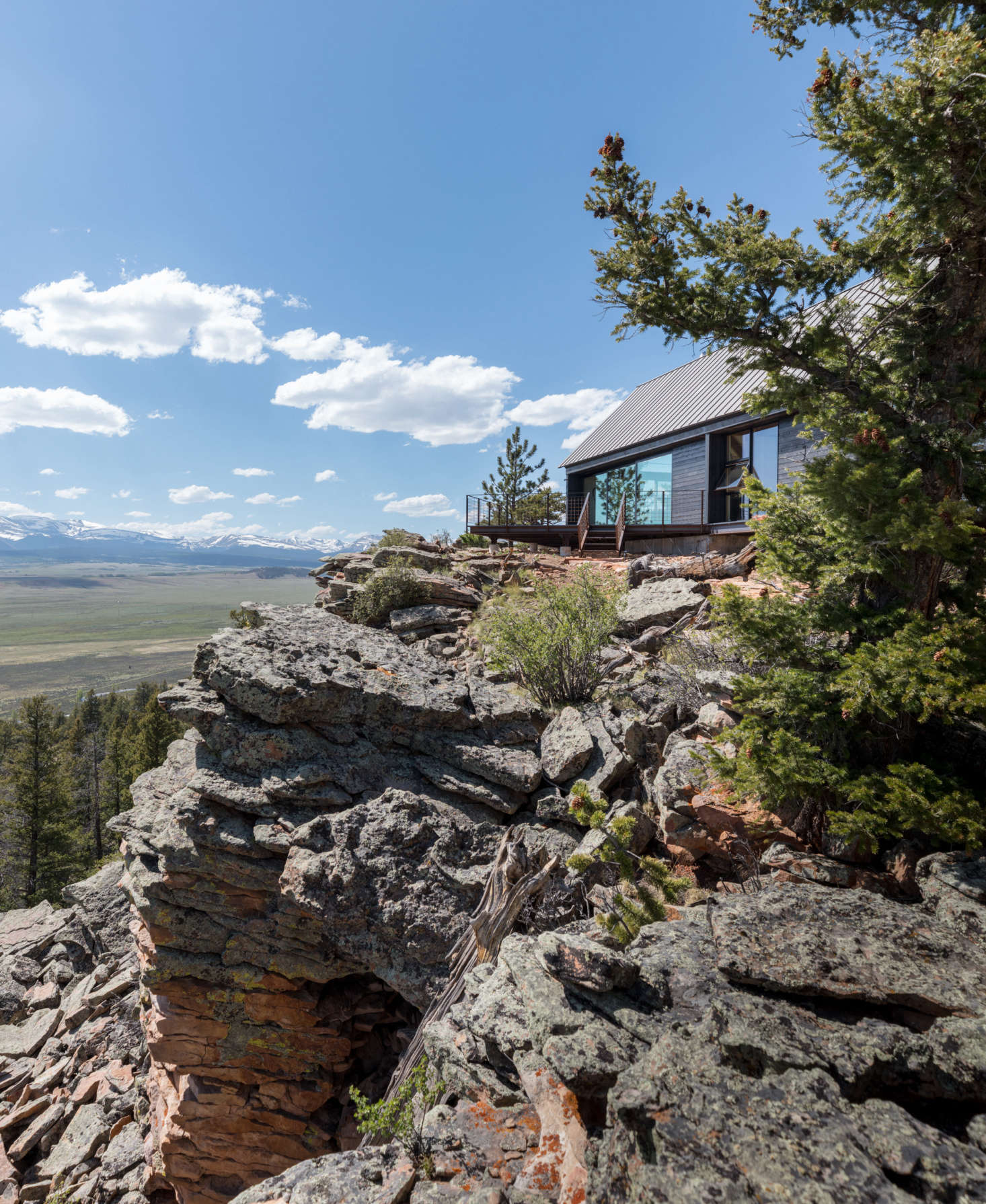 """Maricel's design brief was """"I want to feel as if I'm perched out on that cliff."""" Del Gaudio complied: situated over the South Platt River, the main house faces due south looking out to the Sangre de Cristo Mountains and Collegiate Peaks of the Rockies."""