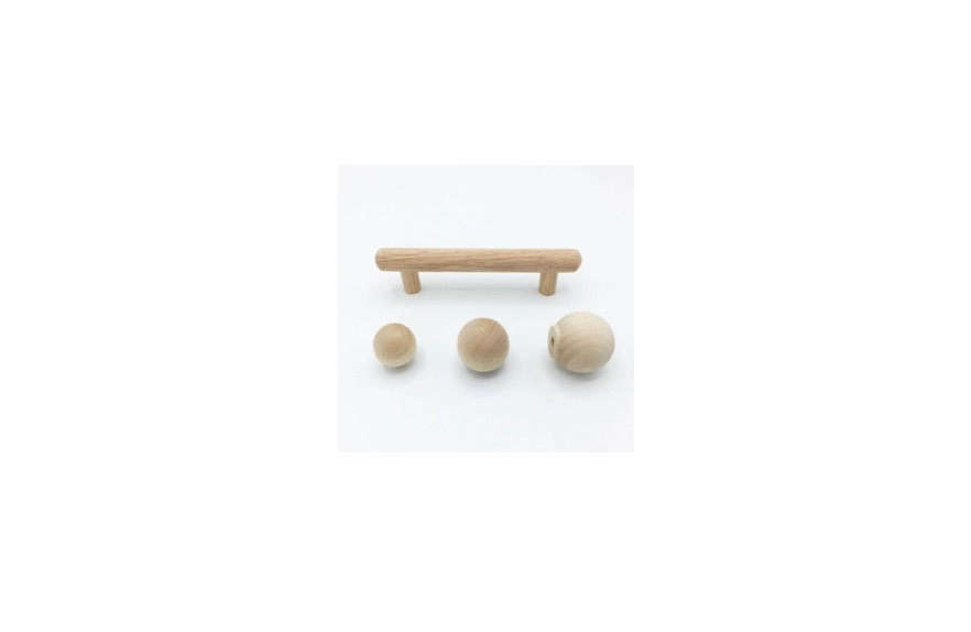 The console was fabricated by ABR Molding; the wooden knobs were painted to match. Try the Wood Midcentury Modern Cabinet Hardware from Forge Hardware Studio for a similar look; the round knobs are $4.99 to $5.99.
