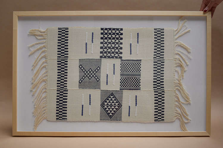 A Framed Dyula Textile is $250.