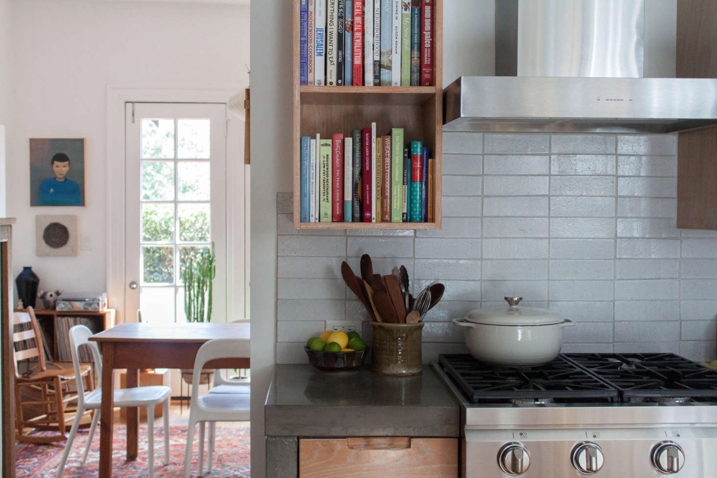 Fireclay tiles make up the backsplash. The utensil holder is by local potter Wade Franklin.