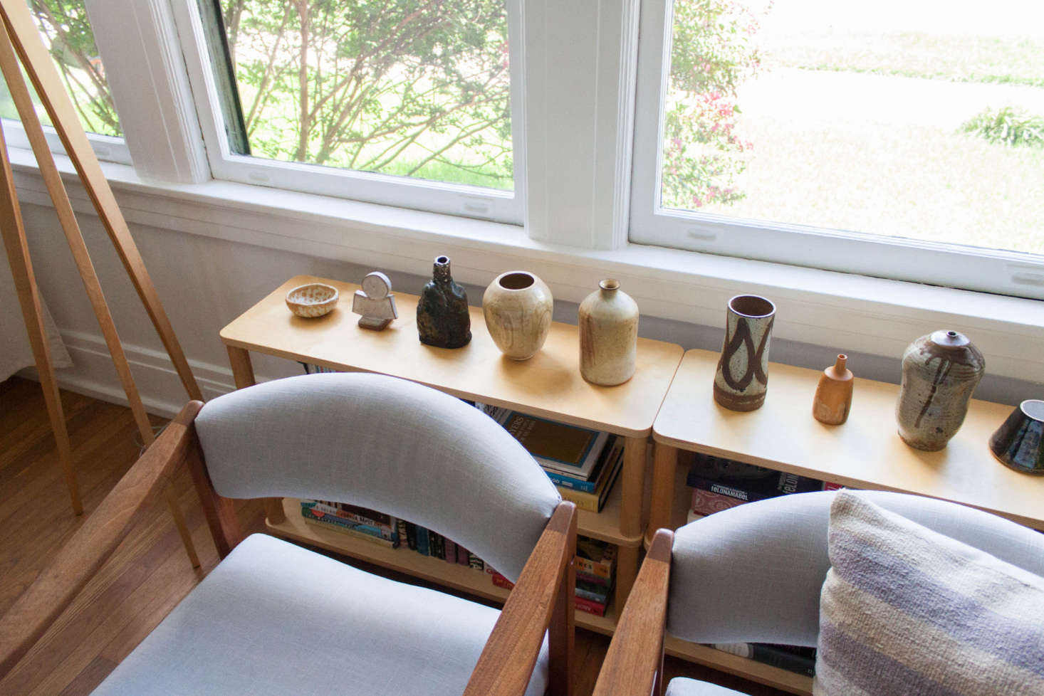 Gabi had the vintage armchairs reupholstered. She collects pottery—both secondhand and new from local potters—and displays them throughout her home.