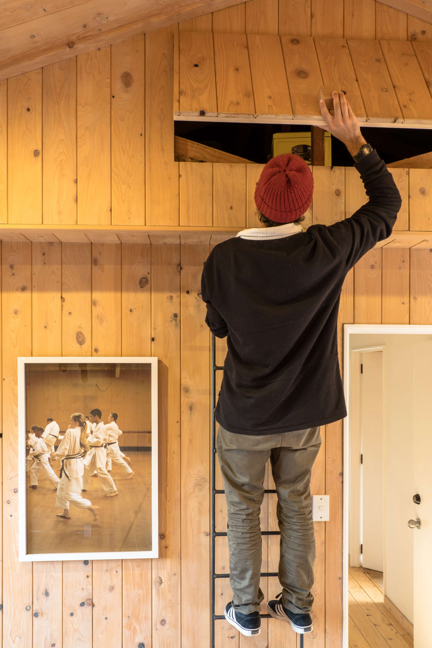 """The storage area is accessed by a steel ladder. """"Ceiling spaces are nice and dry, which is good for storage,"""" says George."""