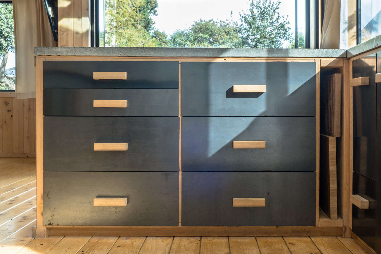 """The steel-fronted drawers have handmade wooden pulls. In hindsight, George says, it would have been more cost-effective to buy kitchen cabinets than to build them: """"sometimes doing it yourself actually costs more."""""""