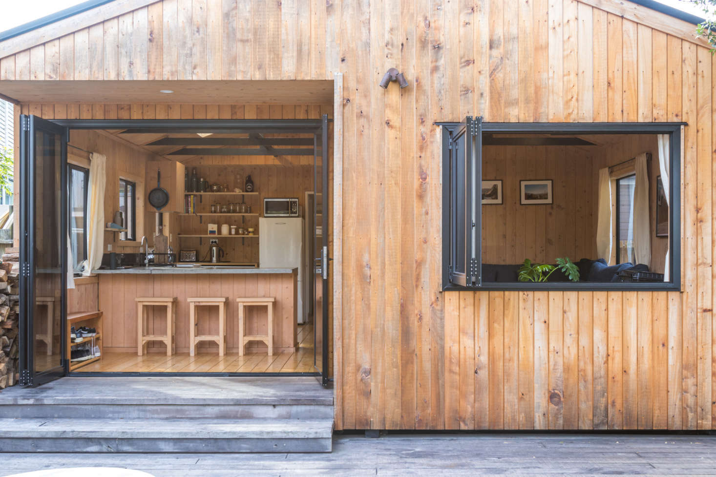 Double-glazed bifold doors and a new window open the living area to the deck.