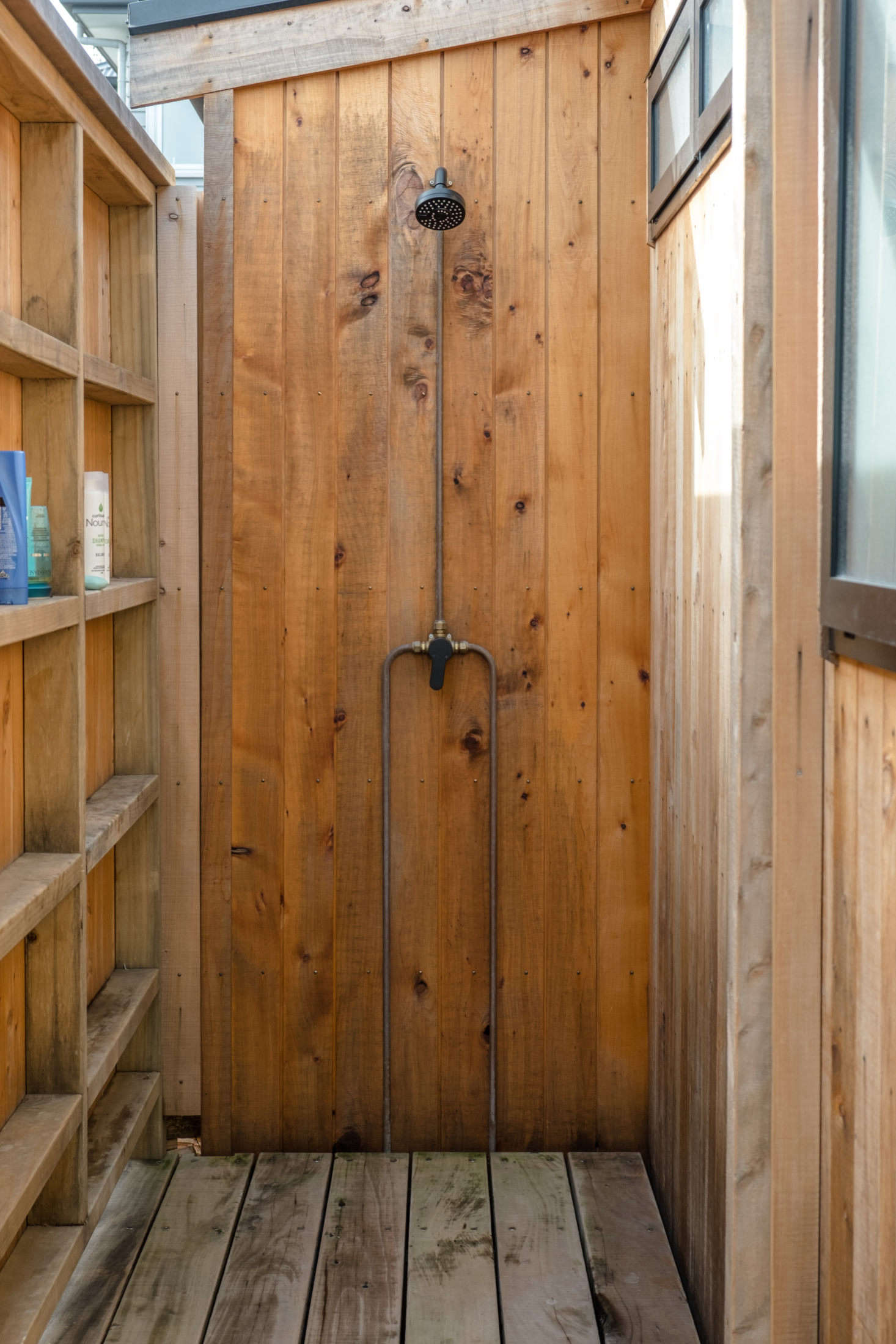 To complete the cabin vibe, there's an outdoor shower in the back.