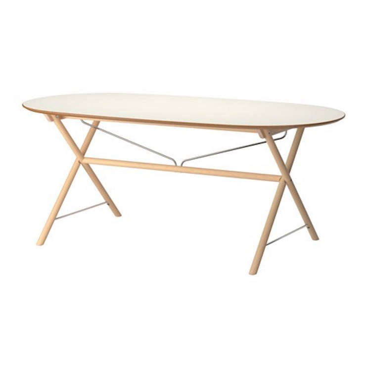 Ikea's Slahult Table features white birch legs with a melamine tabletop; $189.