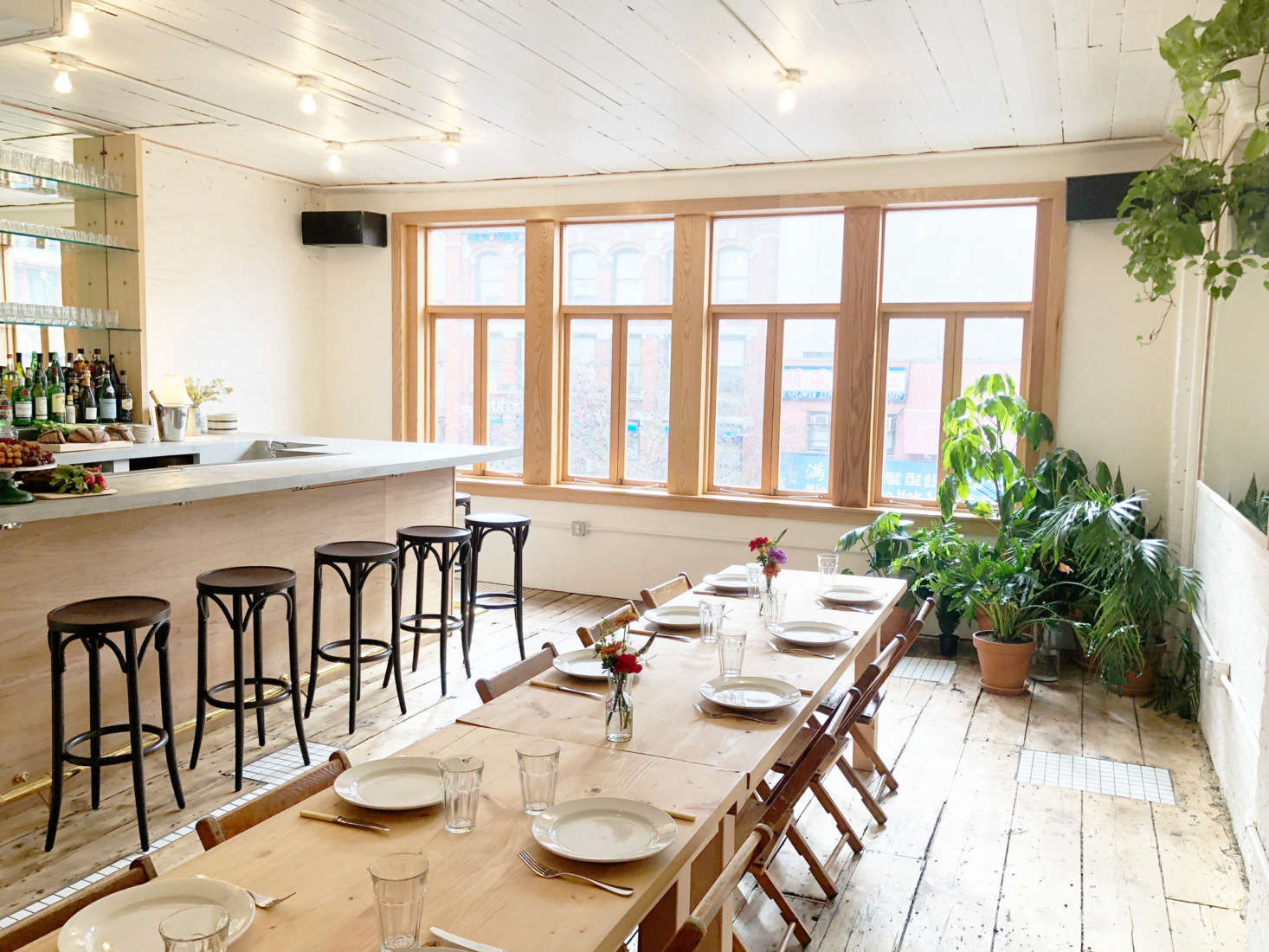 """The third floor has no attached kitchen but does have a bar. """"We connected the spaces with a dumbwaiter so we can send food upstairs from the kitchen,"""" he says."""