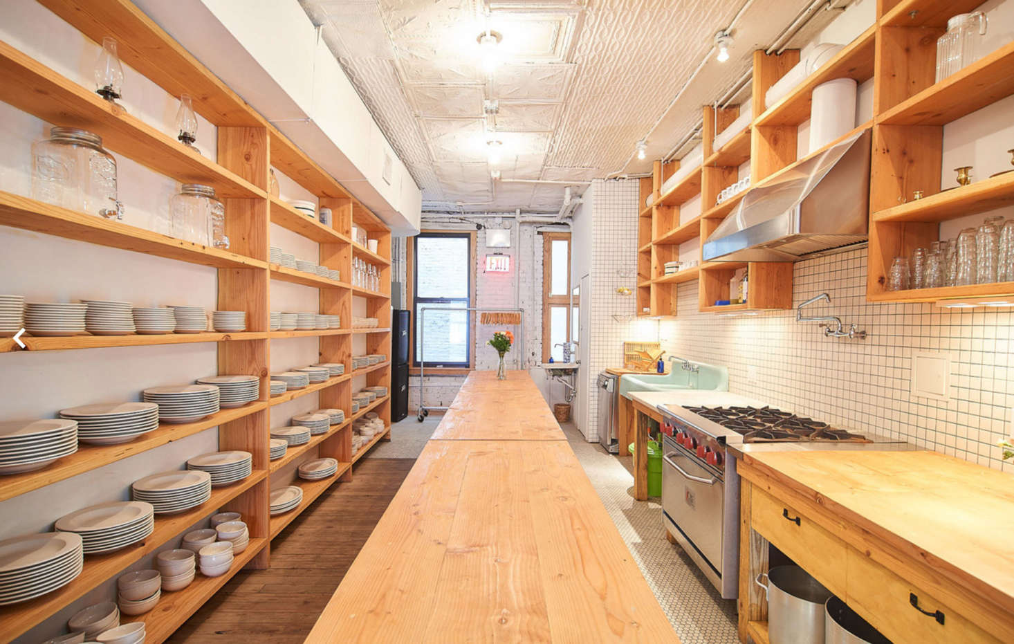 All the wood shelves and tables were designed by Poe. The built-ins in the kitchen are his homage to Donald Judd's bookshelves.