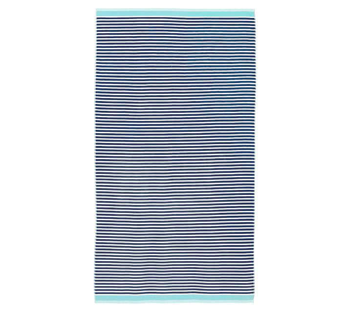 The cotton Mini Stripe Beach Towel (shown above in navy and seabreeze) is on sale for $27 (down from $39.50) at Pottery Barn. It's also available in red/navy and aqua/yellow.