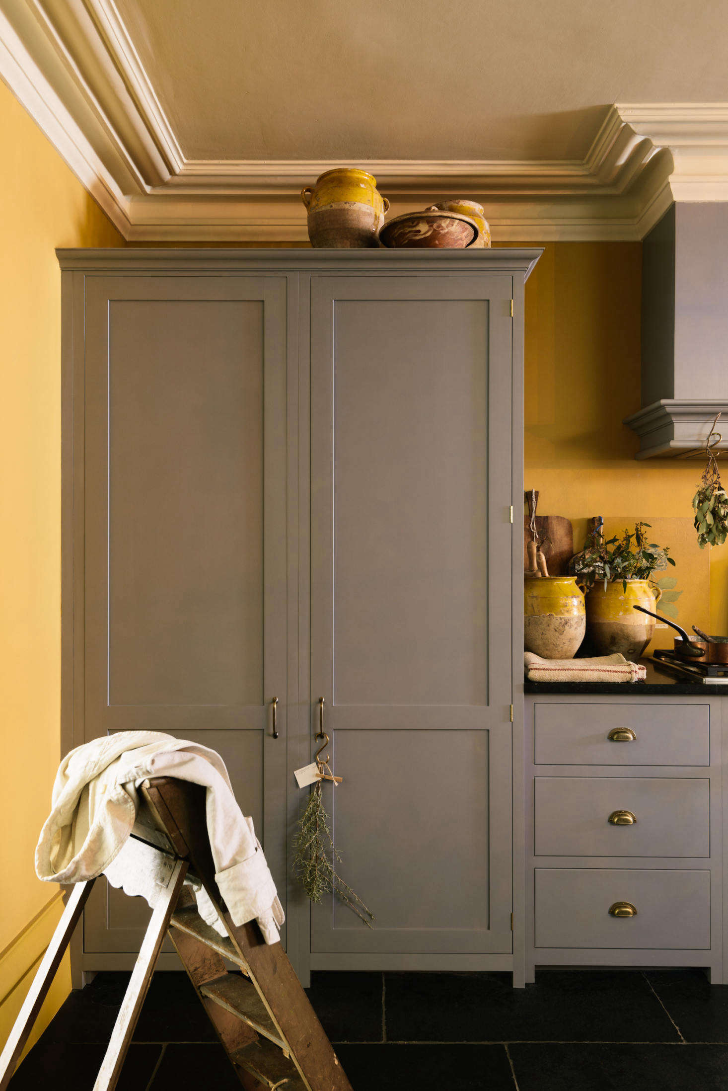 A full-sized Sub-Zero is hidden behind the left door of this tall cabinet. The door on the right conceals the larder.