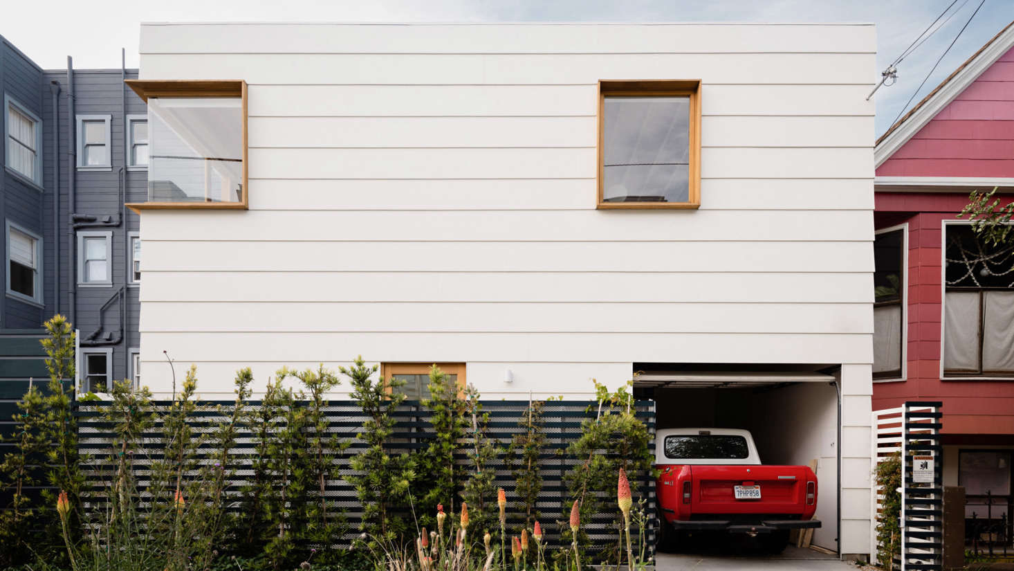 """""""The extruded white oak window boxes on the new structure give a nod to the more traditional approach to window casings while making them more three dimensional,"""" notes Ryan."""