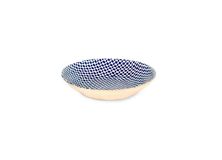 Ban has several blue serving bowls on display. This 16-inch-wide Centerpiece Bowl by Terrafirma Ceramics is $244.95.