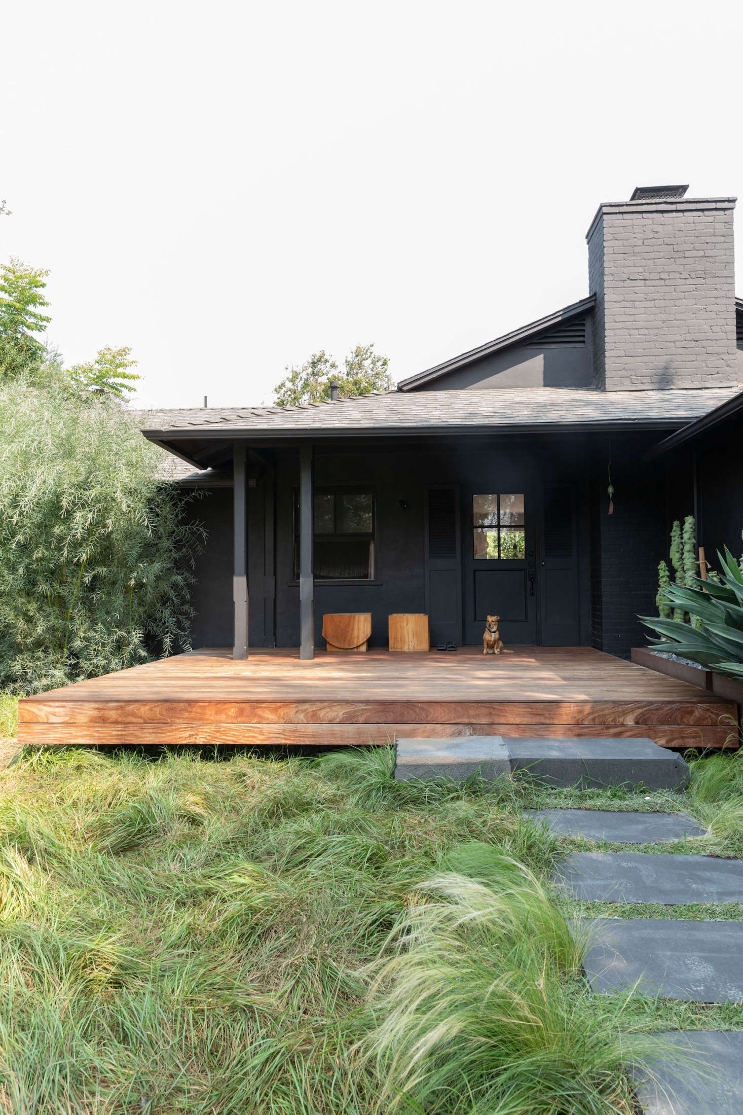 A tousled lawn and black exterior immediately let visitors know this isn't an average suburban home.