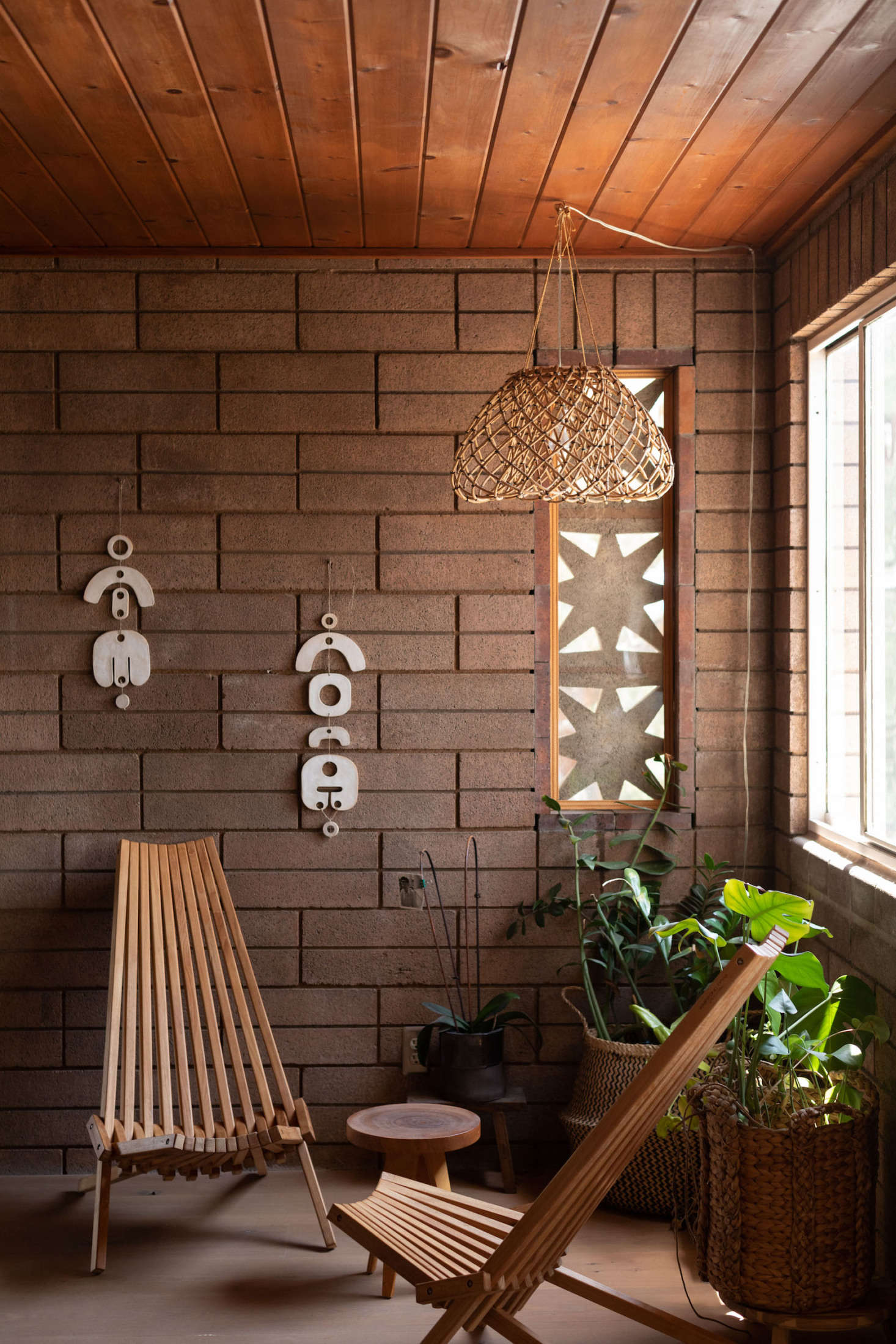 The lamp and wall hangings are all by Wilkinson. For similar foldable chairs, check out GloDea.