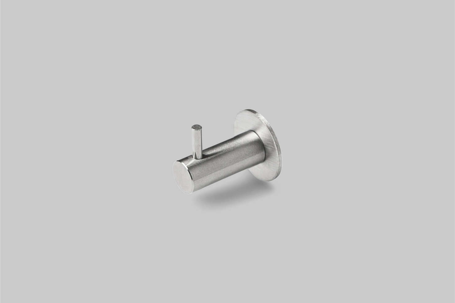 The D-Line Knud Coat Hook with Pin, in satin or polished nickel, is $68 at Casson Hardware.See the hook in action in Design Sleuth: D-Line Hardware from Denmark.