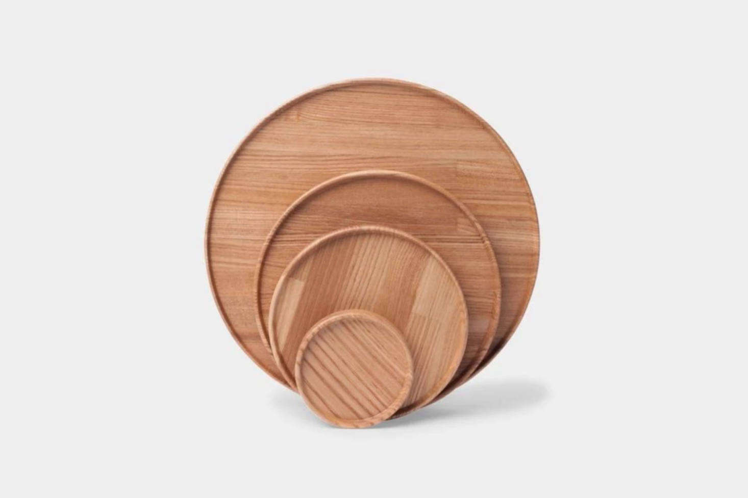 The Hasami Porcelain Round Trays in Ash Wood comes in a range of sizes—5