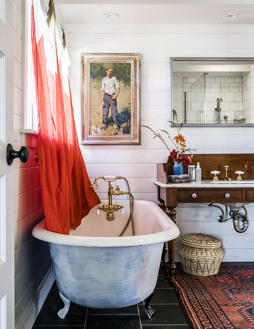 Also from Second Use: the circa-s tub in the master bath. A pair of signal flags found in Provincetown make charming curtains.