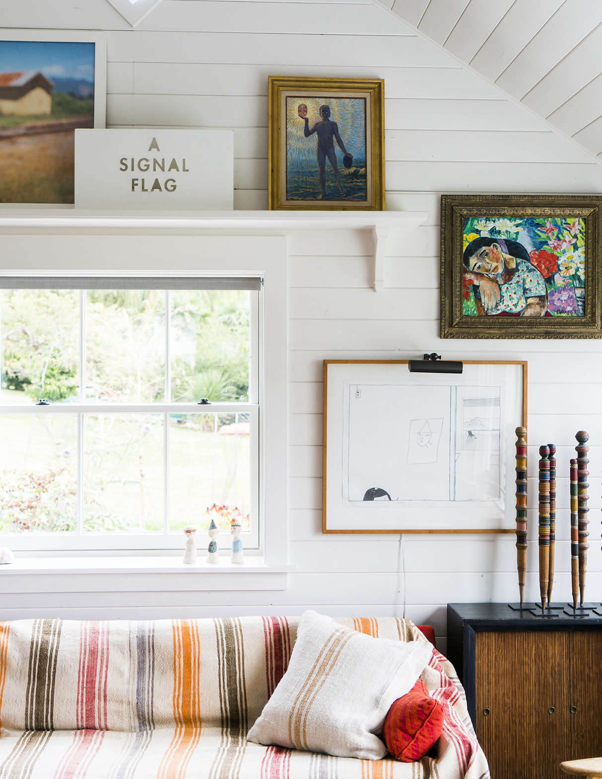 The cedar-paneled walls in every room were painted a soft white for cohesiveness.