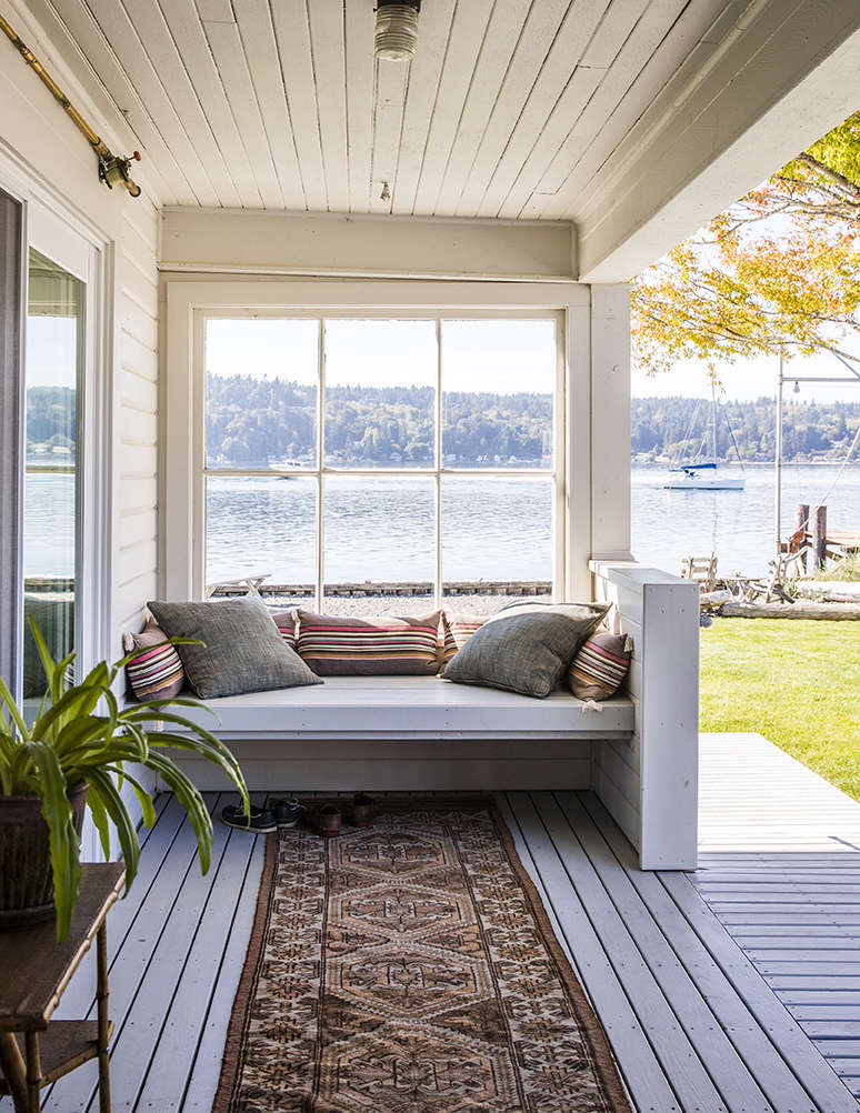 The couple added a window to the original front porch to make it an all-season sitting area.