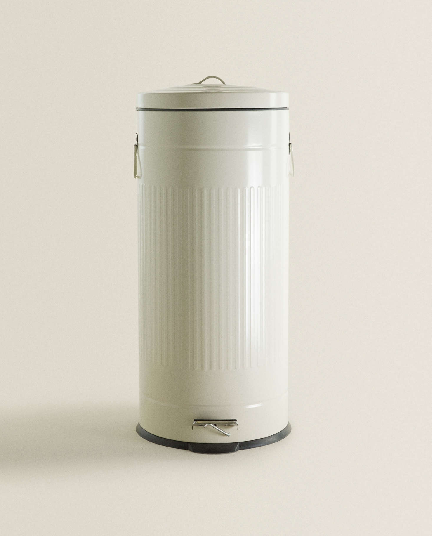 A sleek iron Kitchen Trash Can is $99.90.