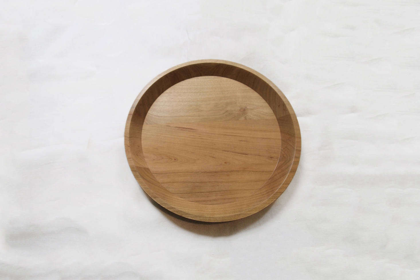 The Masahi Ifuji Tray in Cherry is .5 inches in diameter for $0 at Makié.