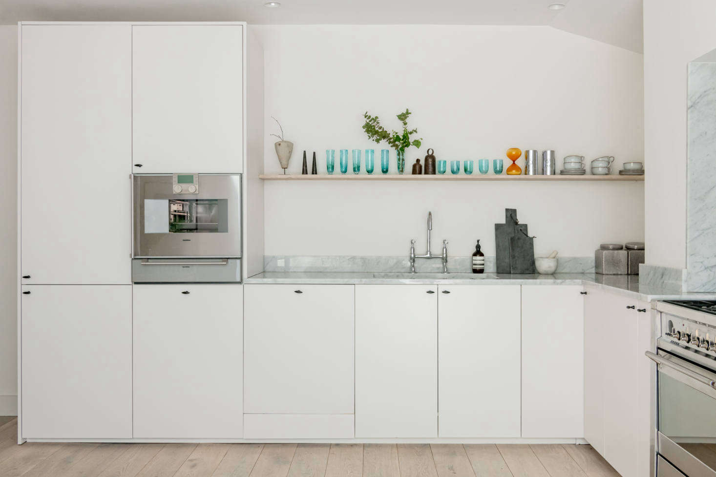 """Also up-cycled were all the appliances. """"My client gave me the warming drawer and steam oven, and my brother-in-law his Siemens range, all of which was only five-years-old."""""""