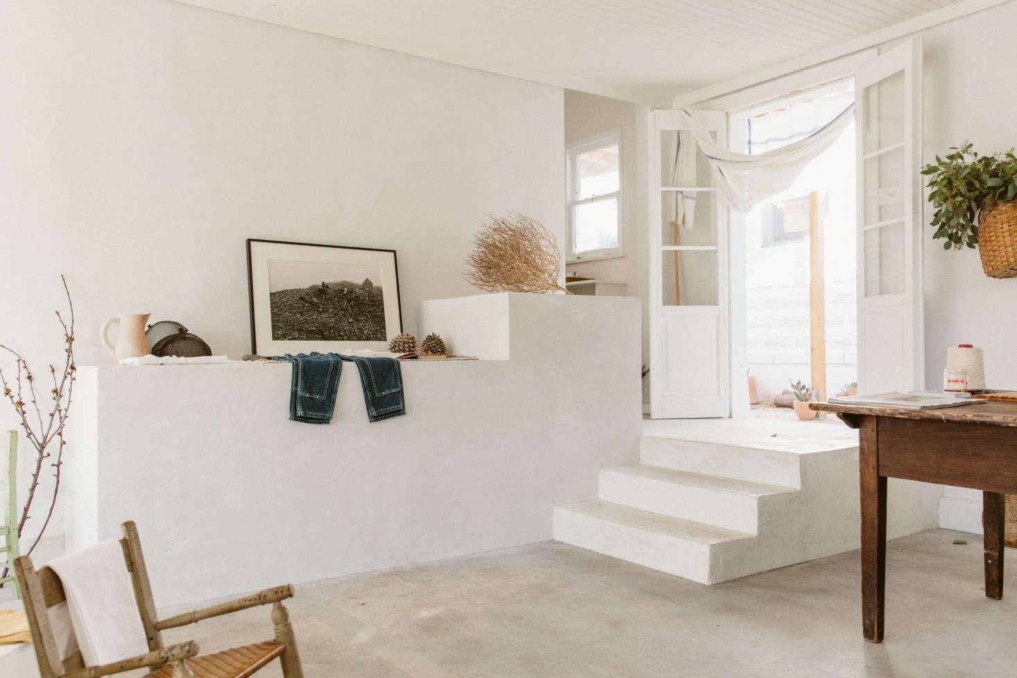 Along one wall of the small space, the couple added a wide, stepped pedestal reminiscent of their Maine house and Esteves' training as a sculptor. (It's white concrete, O'Rourke says, finished in the same plaster mixture as the walls.)