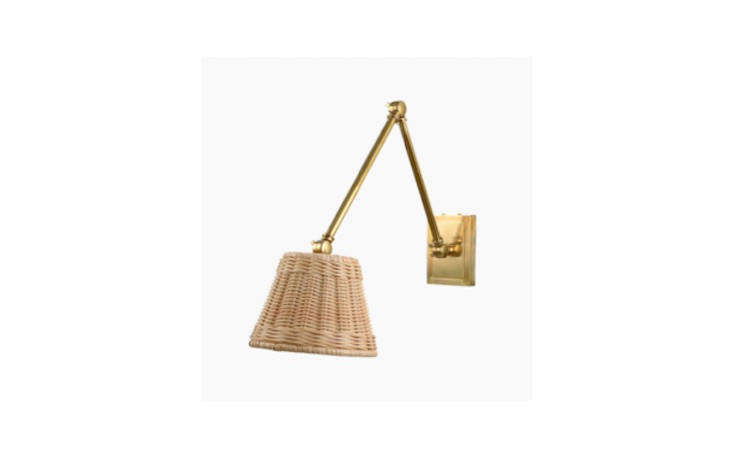 The Avon Wall Light with Rattan Shade comes in different metals (pictured is brass).