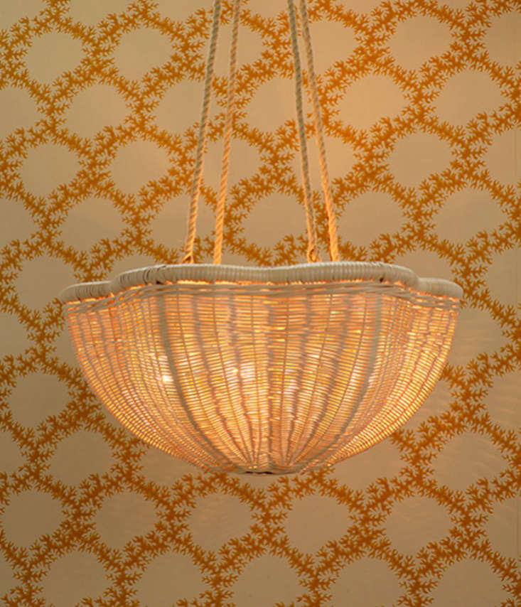 The Rattan Daisy Hanging Light with Rope Chain, in small, measures  inches across.