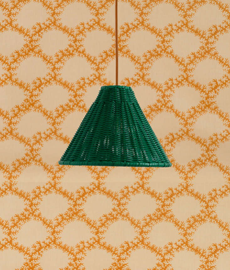 Each piece is available in a slew of finishes. Pictured is the emerald Rattan Hanging Cone Light.