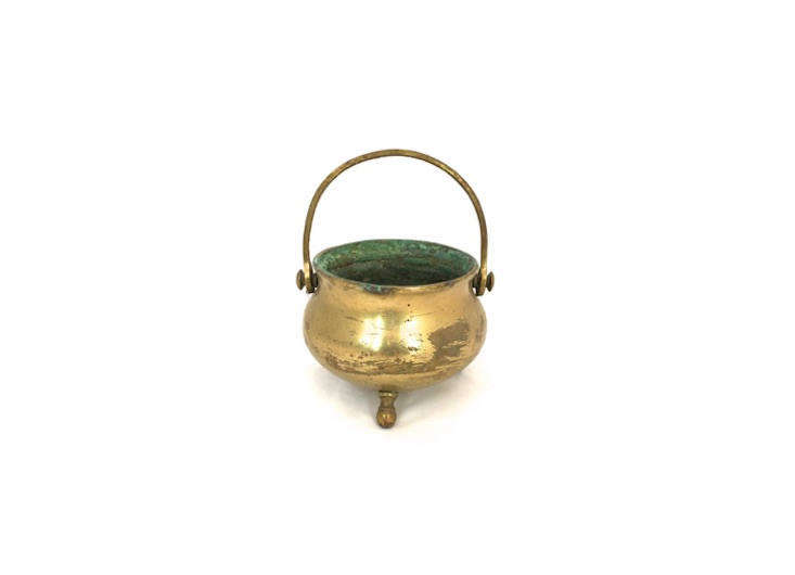 This Vintage Rustic Brass Cauldron has a diameter of 4.5 inches, perfect for corralling flatware; $31.41 on Etsy.