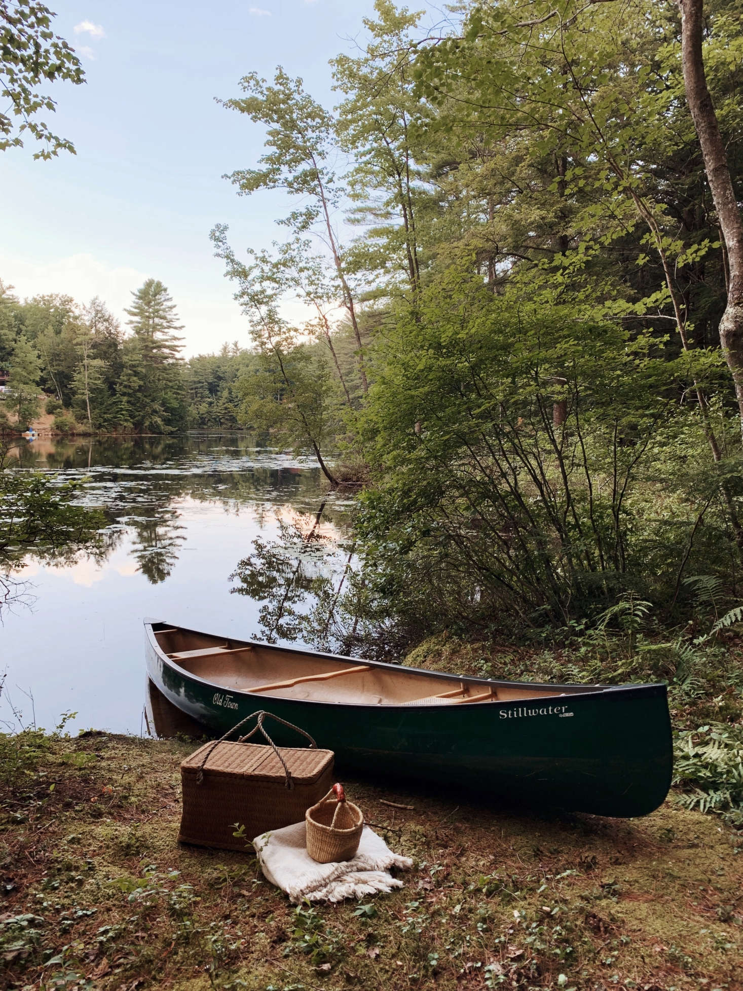 A canoe is always ready by the pond for a picnic—or a paddle out to get service.