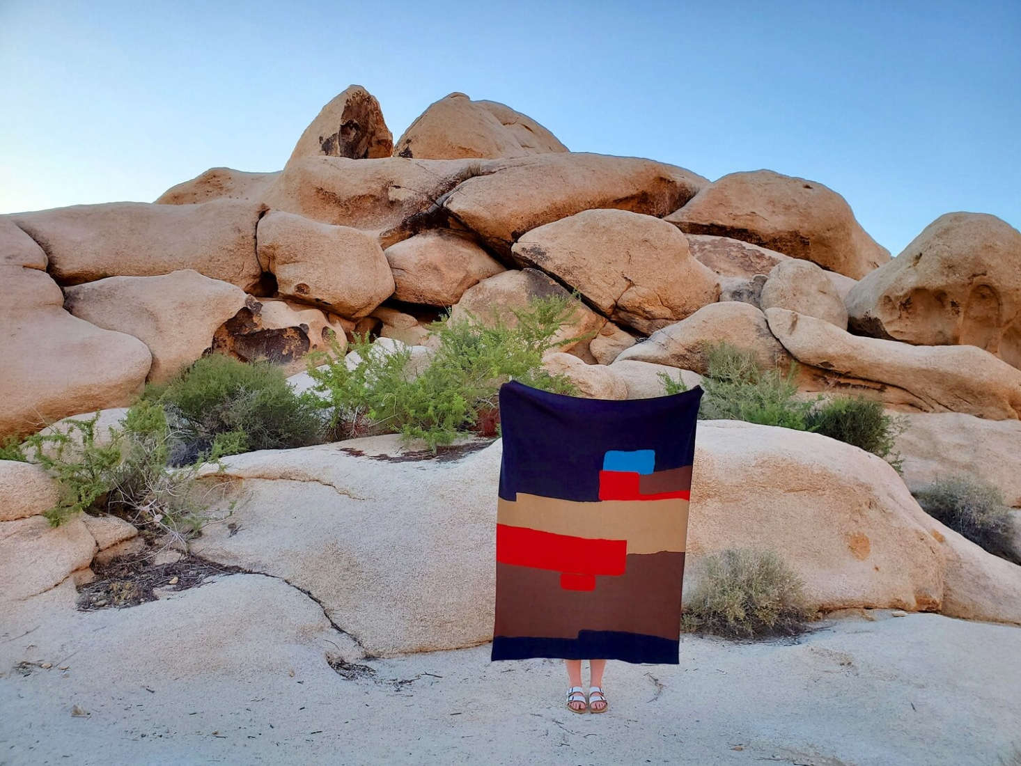 All Roads, a metal and fiber arts collective in the Mojave Desert, makes hand-woven throws from recycled cotton. Both the Agua Fria Blanket (pictured here) and the Desert Sun Blanket (featured at top) are $8 each.