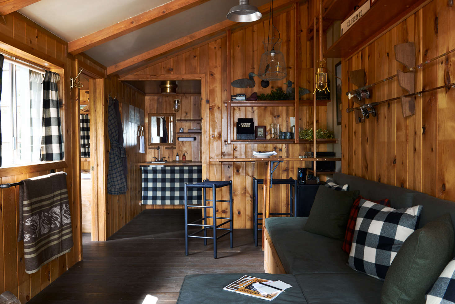 The sitting area of the Filson-decorated cabin.