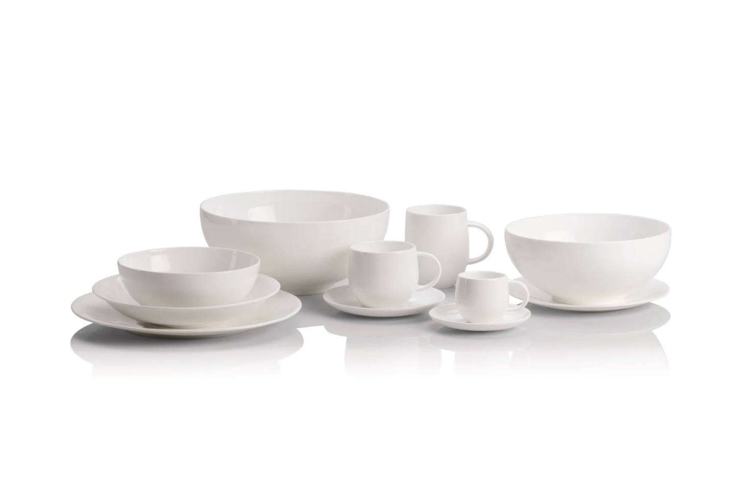 """Abvoe: Italian architect Guido Venturini designed the All-Time Dinnerware for Alessi with """"fluid forms and clean lines"""" in bone china. Each piece is designed to softly reflect light. The 13-Piece All-Time Table Set is $240 at Alessi; serving pieces and additional cups are also available."""