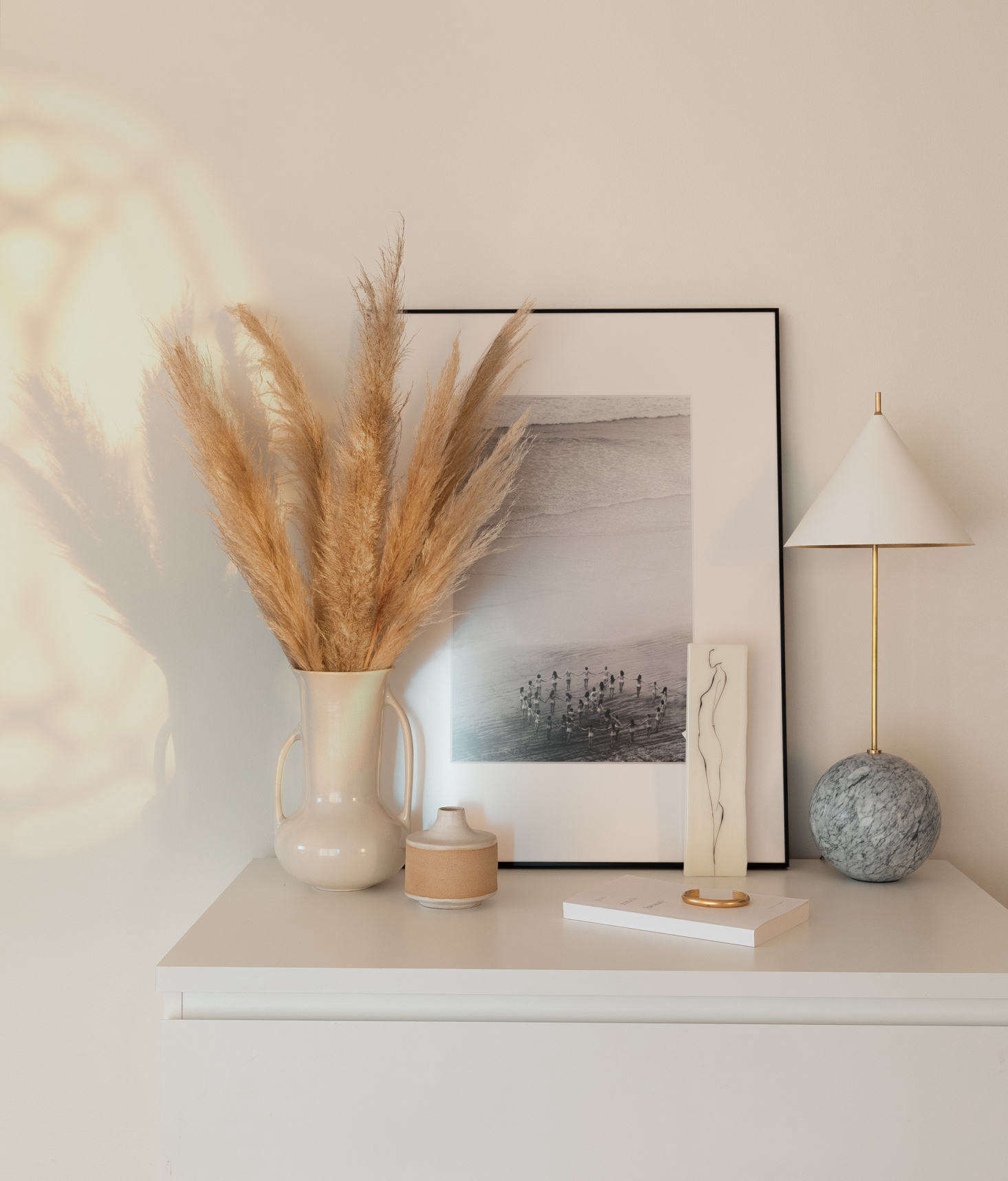 A still-life on an Ikea dresser. The  light is the Cleo Orb Base Table Lamp by Kelly Wearstler for Circa Lighting. Hillary&#8