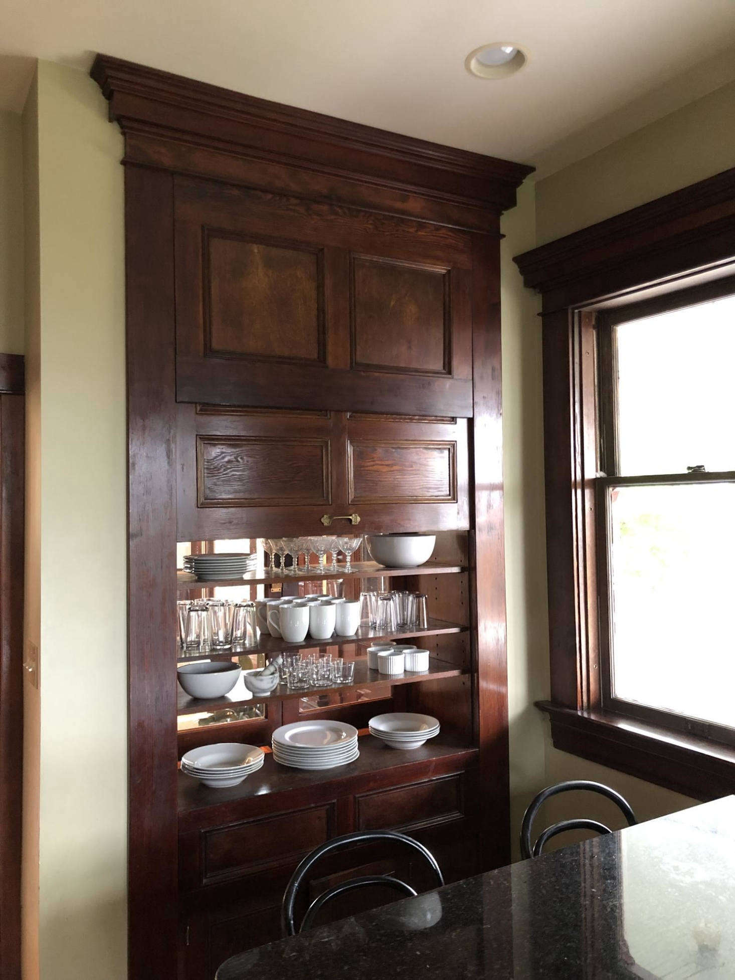 On the other side, the pass-through is concealed behind a paneled door. The kitchen is the one room the couple are waiting to tackle: &#8