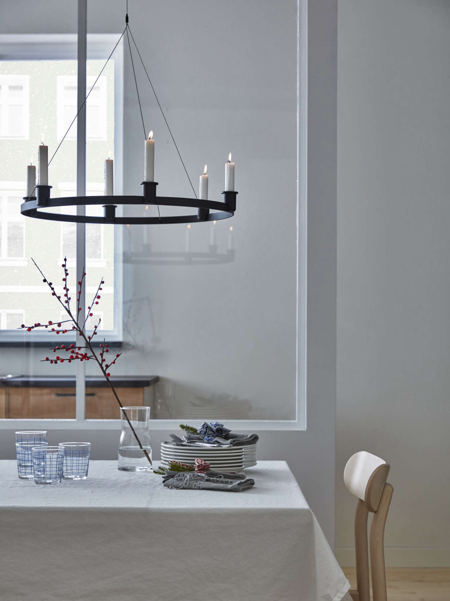 The powder-coated aluminum and steel chandelier holds six candles; $49.99.